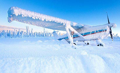airplane covered in snow